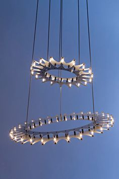 Schprokets is a gear-shaped lighting fixture designed by Christopher Moulder that uses no wires or sockets, but instead uses low-voltage bulbs that give off a halo-like glow.