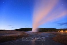 Old Faithful erupts during a fall night in Yellowstone Nationa Park | Jason Savage Photography