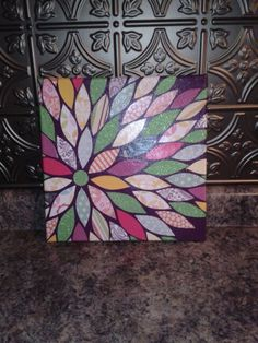 DIY Painted canvas with scrapbook paper cut outs glued on and then used modge podge.