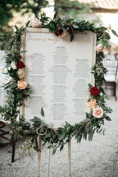 romantic seating chart ideas - photo by Infraordinario Studio http://ruffledblog.com/colorful-dreamy-wedding-in-tuscany