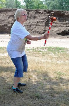 Debbie Engster successfully puts the bobber attached to the plunger on the top.---- several plunger games