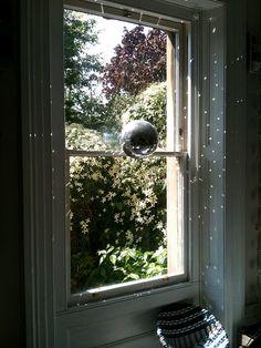 mirror disco ball in a window