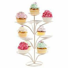 "A whimsical display for your favorite sweet treats, this charming metal cupcake tree showcases a cream hue and swirled bases.   Product: Cupcake treeConstruction Material: MetalColor: CreamFeatures: Holds 13 cupcakesDimensions: 14"" H x 7"" Diameter"