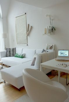 I love the clean openness of all white rooms but I don't think I could really live in one :)