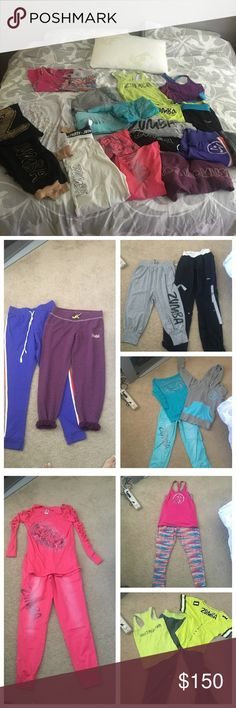 """Zumba wardrobe size small 20 items Free NWT GIFT!! TONS OF Zumba clothing. All in very good to excellent condition, w exception of the blue pants. Please see pics for details. Included is: one pair black capris, 1 pr purple joggers that say """"feel the music"""", 1 pr full length purple joggers w orange stripe WORN TWICE!!, blue joggers w bleach stain at bottom, am hole, small cut at waist, multicolored pink orange pants, 1 jacket, instructor tank is med/fits lk small. 8 tops total.3 capris 8…"""
