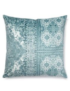 Add a touch of style and comfort with this modern cushion with a bold design.