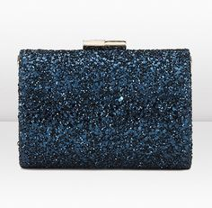 This clutch grabbed at my heart. It also comes in a copper/sparkly brown I can't seem to find online.