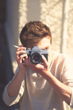 Cute guy with camera, but a ciggarette.....Really??