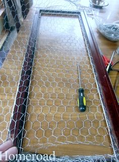 Upcycling a China Cabinet Door with Chicken Wire.