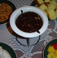 Chocolate Fondue.  NOTE:  made this twice over the holidays with Nestle's chocolate chips and used half and half.  The kids LOVED it.  Was REALLY easy, too.  They especially liked dipping shortbread cookies and graham crackers.