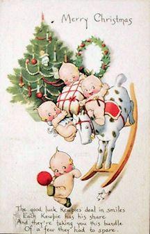 Christmas Kewpie's by Rose O'Neill (1874-1944), postcard illustrator