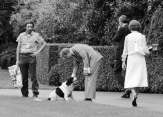 Jimmy Carter pets his daughter's dog Grits: