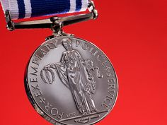 The Police Long Service And Good Conduct Medal, created in 1951 by King George VI, is presented to officers who have completed 22 years unblemished police service. British Medals, Manchester Police, Service Medals, Emergency Response, King George, How To Find Out, Awards, Symbols, Decorations