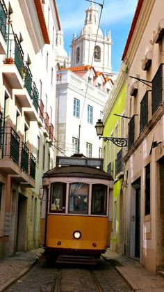 LIsbon - the tram and the narrow streets of the old district #Portugal