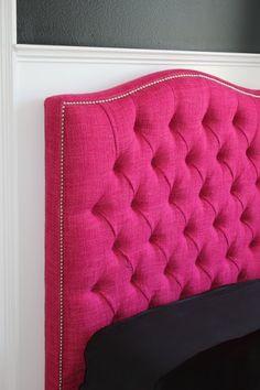 hot pink tufted headboard.
