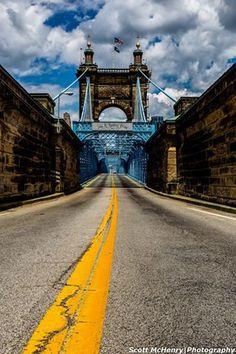 John A. Roebling Suspension Bridge in  .... Cincinnati Ohio.  Brooklyn Bridge was built after this was built ----- Roebling wanted to make sure a Suspension Bridge would work