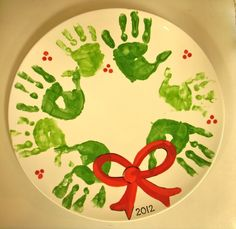 christmas handprint crafts | Handprint wreath painted pottery | Christmas crafts