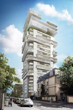 Buro Ole Scheeren's plans for Frankfurt anticipate a growing demand for high-end homes. The firm is converting a 1970s tower into 220 riverside flats