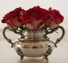 I'd love these roses in Mercury glass vases too