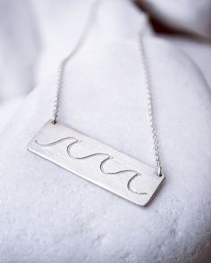 Description Take a quick trip to the Islands with this Wave Necklace from our Paradise collection by Bubble Box! Wear the ocean close to your heart--as it always should be--with this charming little n
