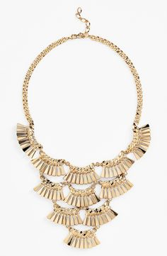 Obsessed with this gold fan bib necklace! Will wear it with a cute LBD.