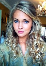 Half up hair do with curls.