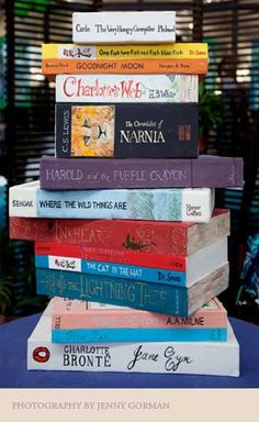 stack of books cake includes Jane Eyre, The Chronicles of Narnia, Charlotte's Web, Dr. Seuss and a ton of other really good books...