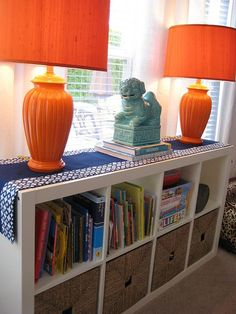 For under the window, Ikea Expedit shelving with baskets to organize everything.orange storage by proteamundi Ikea Cubes, Ikea Expedit, Expedit Bookcase, Cube Shelves, Ikea Shelves, Room Shelves, Home And Living, Living Room, The Design Files