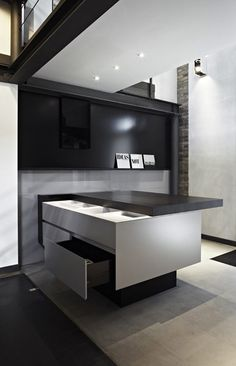 Minimal Sliding Desk - where design fails to meet function: interesting concept - but where does your chair go? on the link it has a laptop open in the right draw front - do you stand up to work?