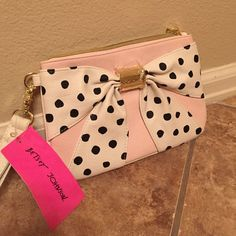 Betsey Johnson polka dot wristlet Brand new! Never used, tags, tissue, and protective covering still attached. Baby pink wristlet with white bow covered in black polka dots, gold accents. Betsey Johnson Bags Clutches & Wristlets