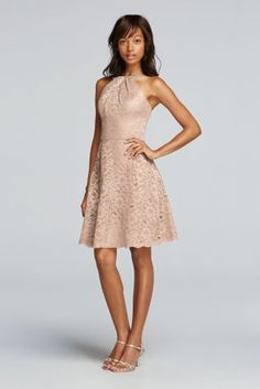 A look and feel that your bridesmaids will love, this short all over lace dress can be worn for your special day and beyond.   Front y-neck with tank straps in back.  Above the knee skirt length with scalloped hem.  Fully lined. Imported. Back zip. Dry clean only.  To protect your dress, try our Non Woven Garment Bag.