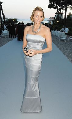 May 2010: Charlene made her dazzling society debut at the amfAR's Cinema Against AIDS benefit gala, wearing a strapless silver dress with her hair swept into a Veronica Lake-inspired style.