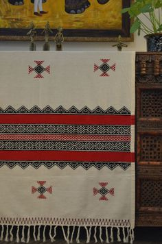 A traditional Toda embroidery e shawl that can be used to brighten a wall in your home too