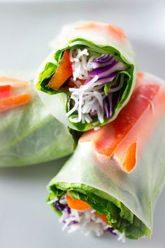 Vegan Salad Spring Rolls - A fresh and delicious way to eat a rainbow medley of vegetables. Accompanied with a sweet & slightly spicy peanut sauce. Perfect for a quick and easy lunch, dinner, or even as a snack. | http://passmesometasty.com