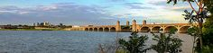 A panoramic view of the South Hanover Street Bridge in South Baltimore. The water is the Patapsco River as viewed from Middle Branch Park.