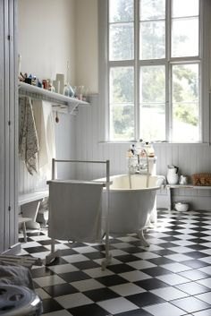Bathroom checkered chess floor. A must when it's time to redo bathroom - my old kitchen is in again