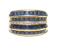 Absolutely stunning vintage ring/band with invisibly set square-cut blue sapphire and pave set diamonds on 18k gold (hallmarked 750, European 18k mark). Comes from a high end estate here in San Antonio. All stones and gold tested for authenticity. Size 6.25 Check out Ribbons Edge for more great pieces of vintage and antique jewelry