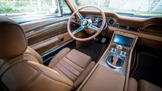The Mustangs interior is quite a bit more luxurious than the 1968 original. Ford Mustang 1967, 68 Mustang Fastback, Ford Mustang Classic, Vintage Mustang, Mustang Cobra, Ford Classic Cars, Ford Mustangs, Mustang Restoration, Car Restoration