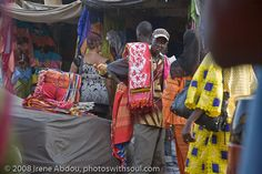 "Darkar Market: the colorful Marché des HLM (""HLM Market) with its long rows of market stalls decorated with colorful fabrics. @Transitions Abroad"