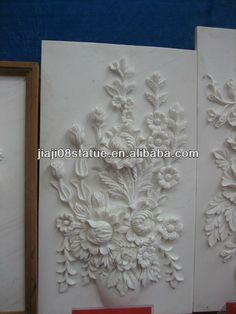 Hand carved stone wall relief carving