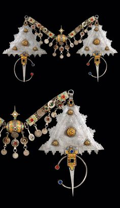 Morocco | Pectoral; pair of Tizerzai fibula ~ silver decorated with enamel and coloured glass cabochons. Connector; silver with enamel and glass cabochons. Coins date fro 1900 - 1920 | Tiznit region, around 1920/30