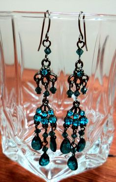 """Alpine Adoration Chandelier Earrings $15.00 Free Shipping! 3""""Length on gunmetal earring wires. Beautiful rhinestone encrusted chandelier earrings accented by Alpine faceted dangles. Add that pop of color and sparkle to any outfit and you'll be sure to stand out!"""
