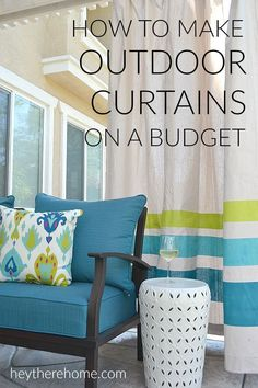 WOW! This outdoor living room is amazing and has so many smart (budget friendly) ideas like these outdoor curtains made from drop cloths!
