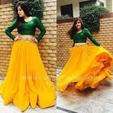 Green crop top with mango colour lehenga. Choli Designs, Lehenga Designs, Blouse Designs, Lehnga Dress, Lehenga Gown, Anarkali, Dress Skirt, Indian Attire, Indian Wear