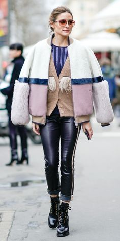 Olivia Palermo continued her stylish fashion parade in Paris. This time, she opted for a fur bomber coat by DROMe, a feather-trimmed sweater, cuffed leather pants, and lace-up boots.