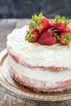 This Easy Strawberry Cake recipe is a lovely summer dessert with the best cream cheese frosting!