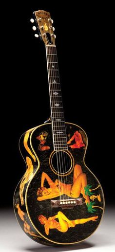 """1928 Gibson Nick Lucas Special with """"special"""" decals. She's a beaut, oh, the guitar as well."""