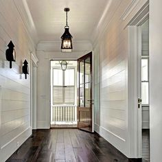 Shiplap lining the halls to a stunning porch lantern! French Quarter on … Shiplap lining the halls to a stunning porch lantern! French Quarter on a ladder rack. French Quarter, Style At Home, Home Design, Interior Design, Porch Lanterns, Decoration Entree, Sweet Home, White Shiplap, White Wood