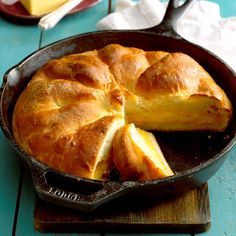 Muenster Bread Recipe -My sister and I won blue ribbons in 4-H with this bread many years ago. The recipe makes a beautiful, round golden loaf. With a layer of cheese peeking out of every slice, it's definitely worth the effort. —Melanie Mero, Ida, Michigan