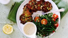 Zucchini and haloumi fritters with green beans and rocket salad